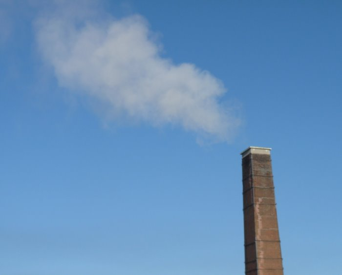 Up in smoke- smoke billowing from a chimney