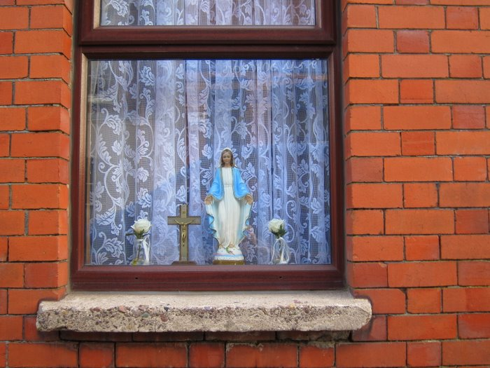 holy statues in a window in a Cork City house.