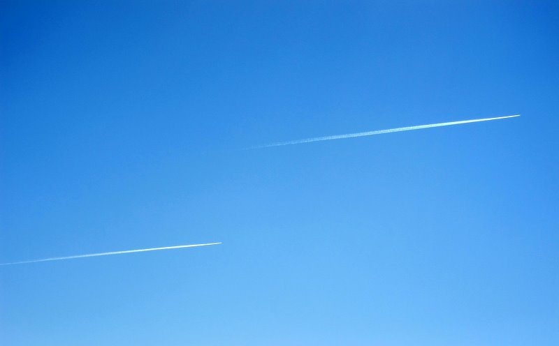 two planes in the blue sky